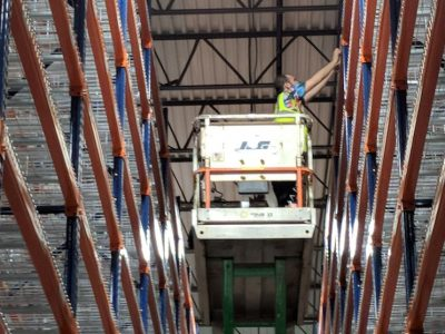 installing warehouse labels on scissor lift