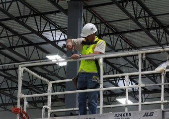 installing conduit to hang warehouse location signs