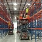 Warehouse Label Installers on Scissor Lifts