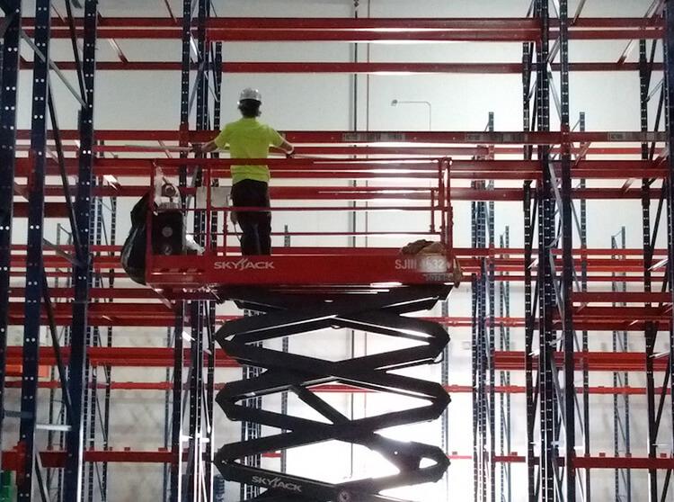 warehouse label installer on lift