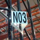 Teepee-style warehouse aisle marker sign