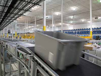 Tote moving on a roller conveyor
