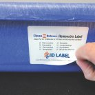 Clean Release removable warehouse label on blue tote