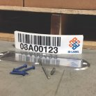 Warehouse floor label kit with aluminum protective cover