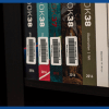Row of library books with barcode labels for tracking