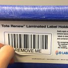 Tote Renew removable warehouse label holder