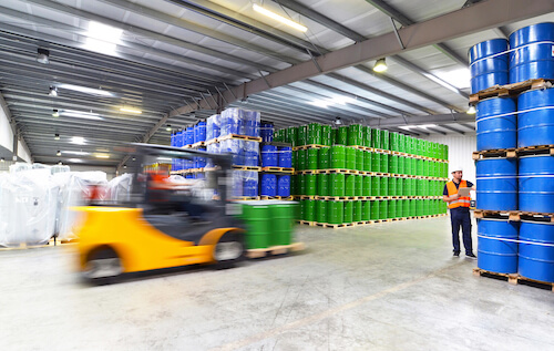 warehouse forklift truck moving chemical drums