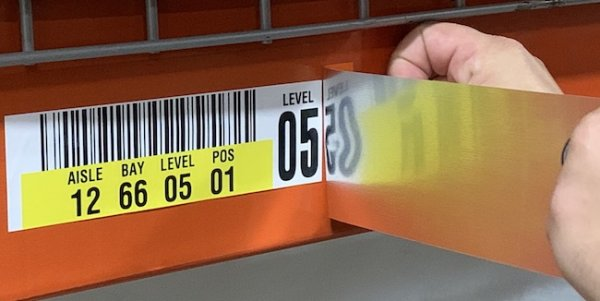 Applying warehouse rack label cover up solution