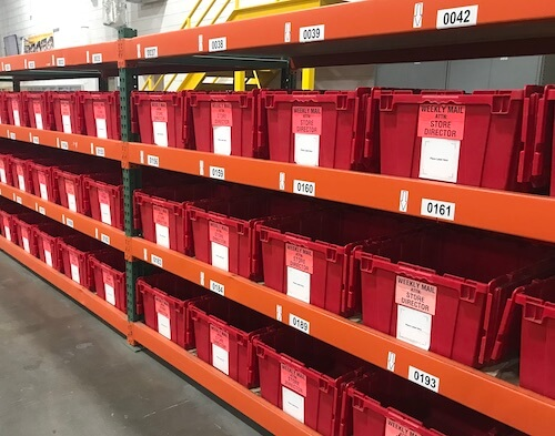 Warehouse totes with tracking labels