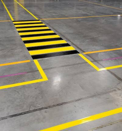 Warehouse floor striped pedestrian path