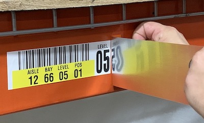 Warehouse rack label cover up relabeling
