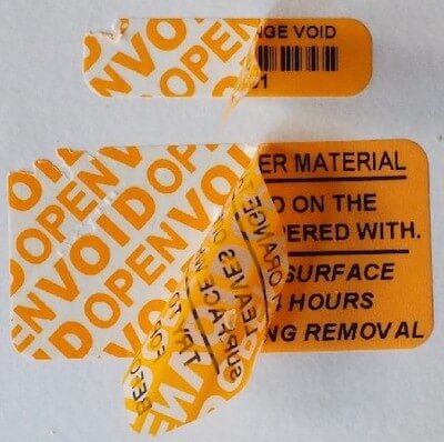 Tamper-evident calibration label with void background