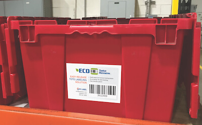 Warehouse tote label with easy-release surface