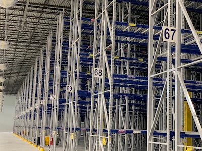 two-sided warehouse aisle numerical signs