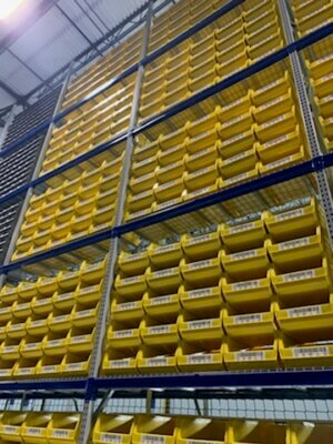 Wide shot of yellow warehouse bins and barcode labels