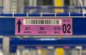 close up of warehouse magnet label on new racking