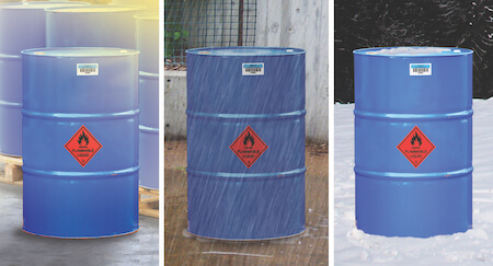 Three chemical drums in sun, rain and snow, each with asset tags