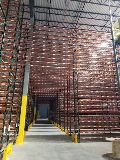 New warehouse rack tunnel with barcode labels